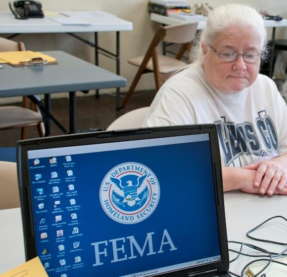 Flood victim Kathy Rayburn visits the Disaster Recovery Center in Olive Hill to get information about recovery aid. Photo by Liz Roll/FEMA