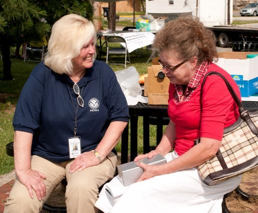 A FEMA mitigation specialist speaks with a flood victim at a FEMA event in Olive Hill, Ky. Photo by: Liz Roll/FEMA