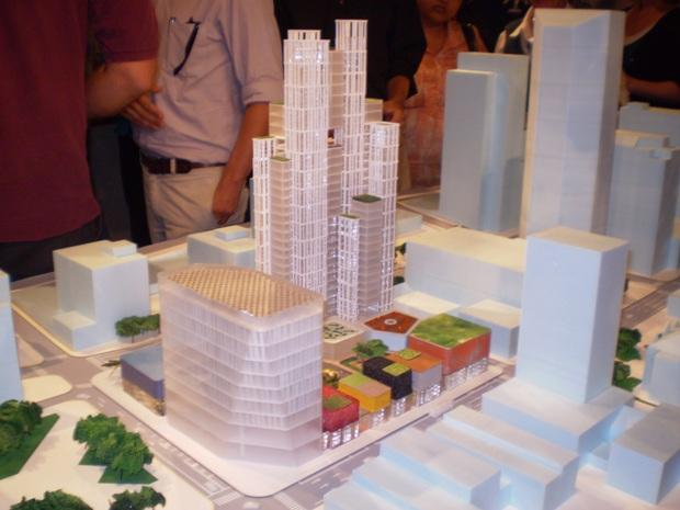 Residents look over a model of the redesigned CentrePointe project.