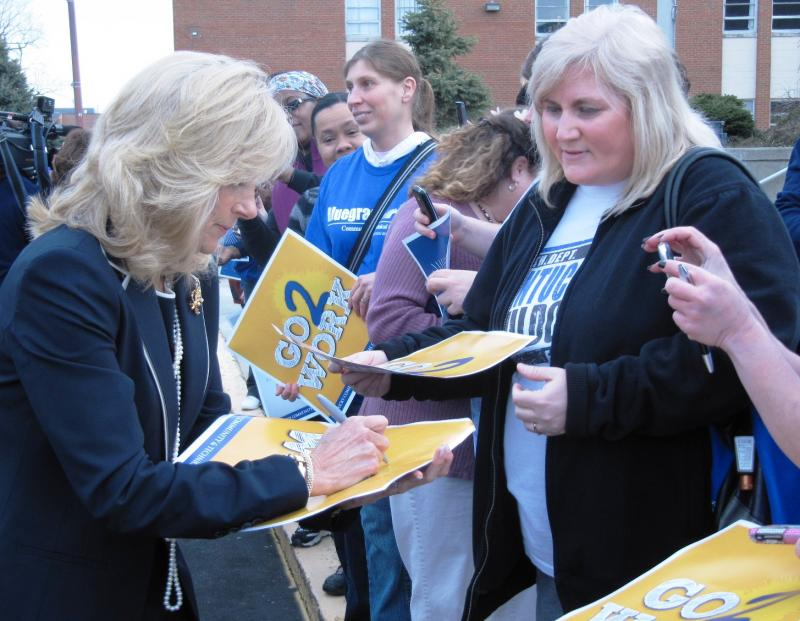 Dr. Jill Biden (left) signs autographs for students and teachers at Bluegrass Community & Technical College