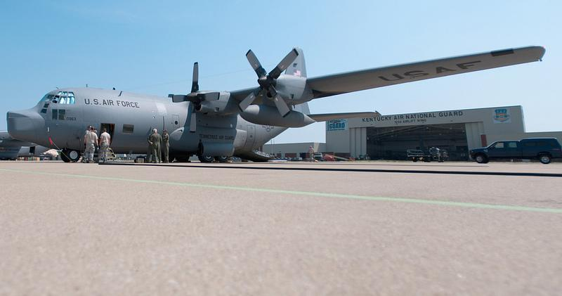 Aircrew members and aircraft maintenance personnel from the 123rd Airlift Wing inspect a former Tennessee Air Guard C-130 on the flight line of the Kentucky Air National Guard Base in Louisville, Ky. (photo by Master Sgt. Phil Speck)