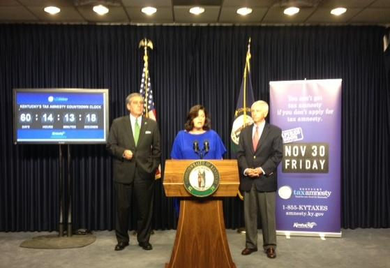 Finance and Administration Secretary Lori Flanery, along with Governor Steve Beshear (right) and Lieutenant Governor Jerry Abramson, address a press conference on tax amnesty