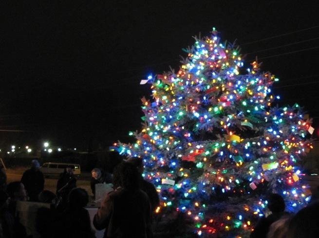 A tree lighting was held Monday at the future home of the Isaac Murphy Memorial Art Garden.