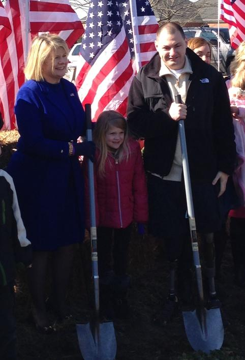 Cpl. Matthew Bradford broke ground Thursday at the site of his new home.