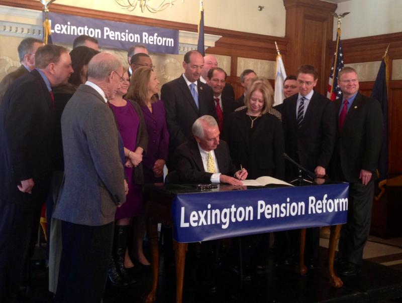 Gov. Steve Beshear signed House Bill 430 while surrounded by Lexington and state leaders