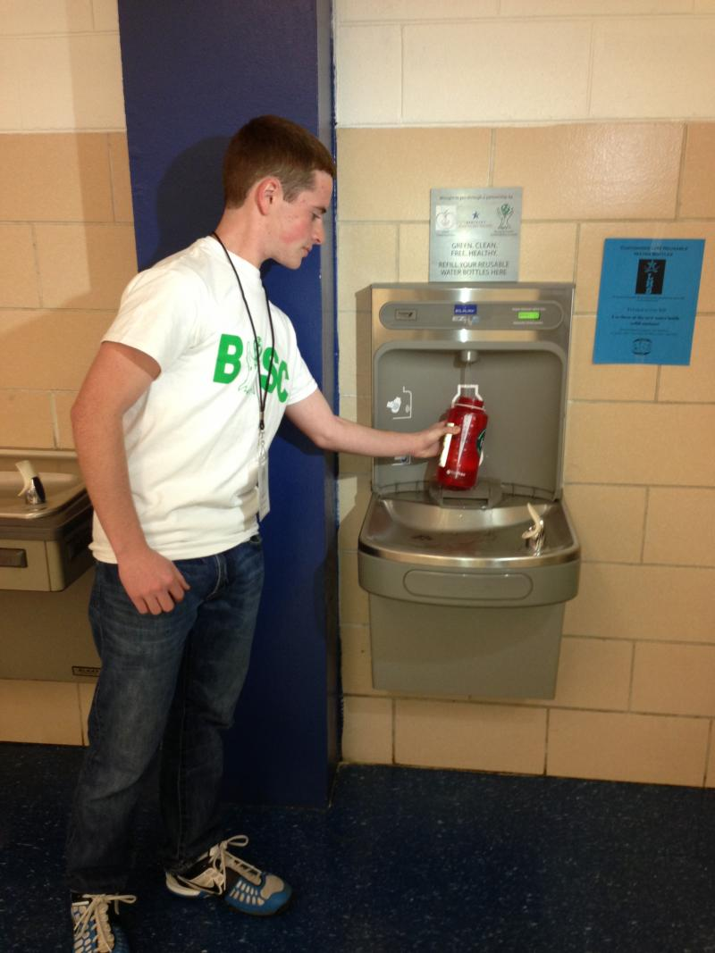 Ben Swanson, a student at Henry Clay High School and member of the Bluegrass Youth Sustainability Council, fills a reusable bottle with tap water.