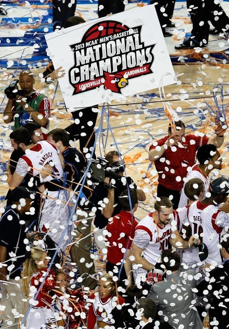 The Louisville Cardinals celebrate after they won 82-76 against the Michigan Wolverines during the 2013 NCAA men's basketball championship at the Georgia Dome Monday night in Atlanta.