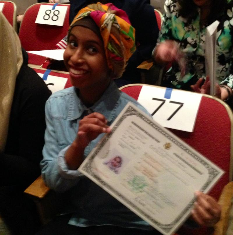 Somali-born Awa Kohi displays her citizenship certificate