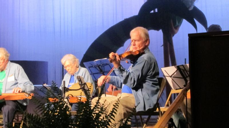 Members of OLLI's Dulcimer Strummers, a folk music group