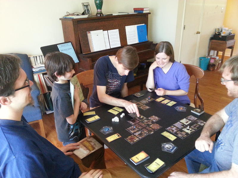 "Gamers play ""Betrayal at House on the Hill,"" where players explore a haunted house."