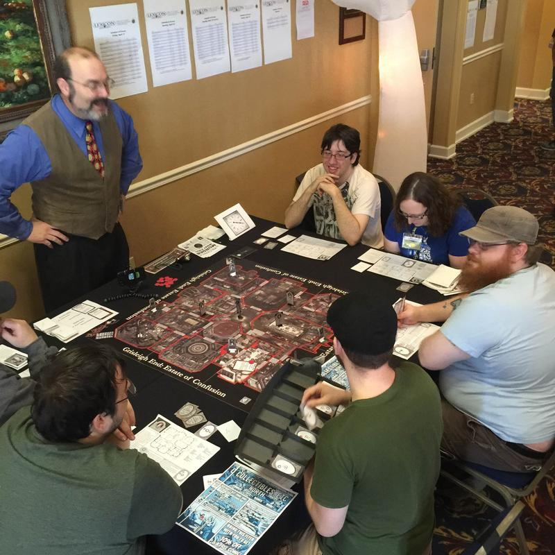 Conventiongoers playtesting Grisleigh End, a pulp mystery game.