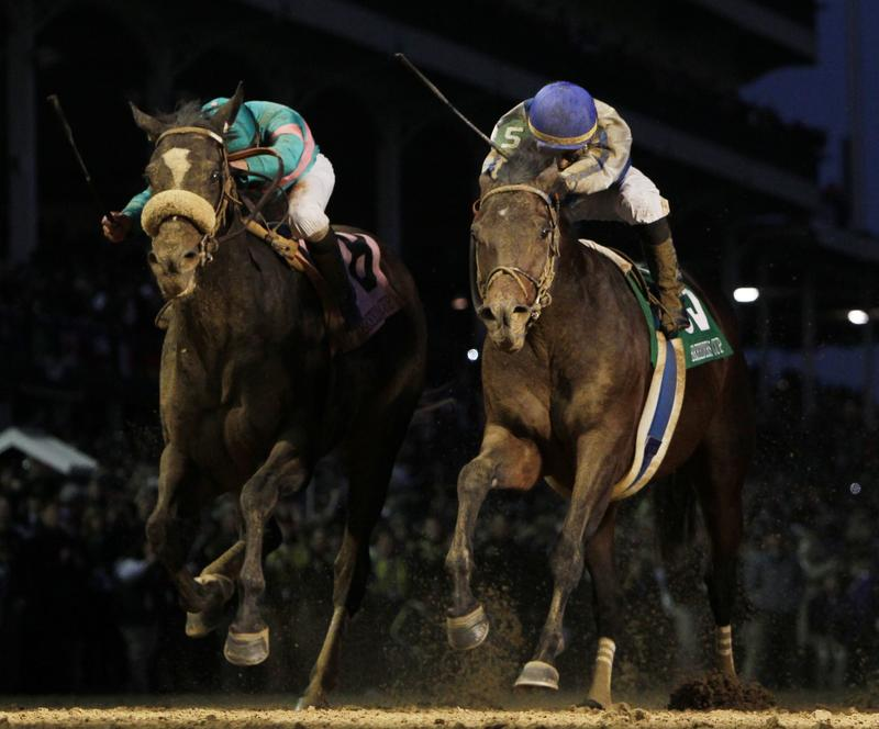 Garrett Gomez, right, rides Blame to victory during the Classic race at the Breeder's Cup horse races at Churchill Downs Saturday, Nov. 6, 2010, in Louisville, Ky. Mike Smith riding Zenyatta finished second. (AP Photo/David J. Phillip)