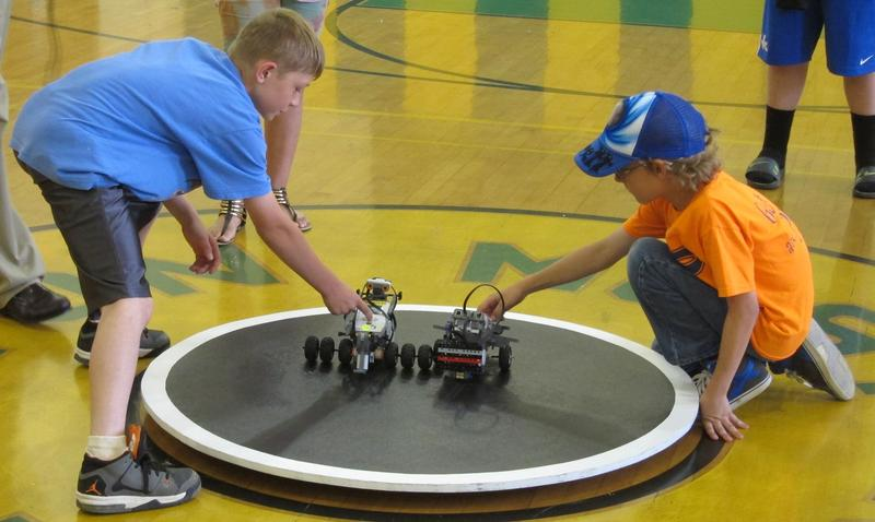 Students readying their robots for battle.