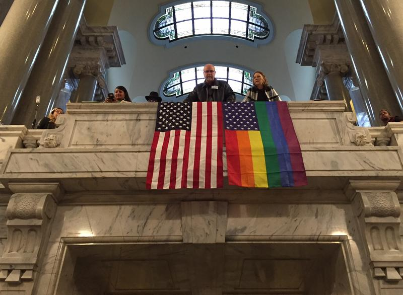 Activists unfurl flags into above the Capitol Rotunda during a rally for LGBT rights during the 2016 legislative session.