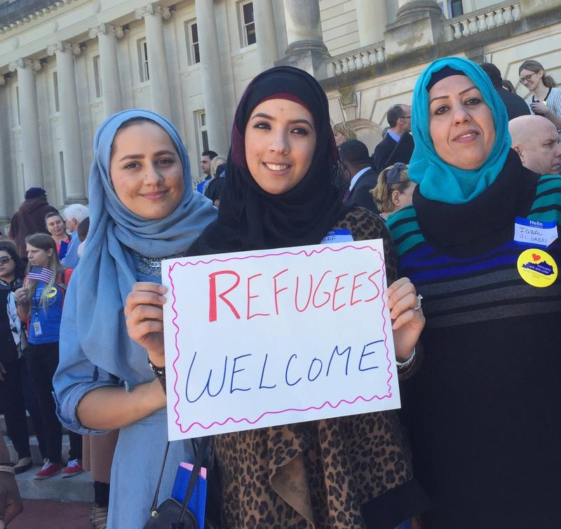 (from the left) Yalda Jamshed, Rahaf Almadhi, and Iqbal Al Gabri rally outside the Kentucky Capitol following a rally for refugees in the Kentucky Capitol Rotunda on March 16, 2016.