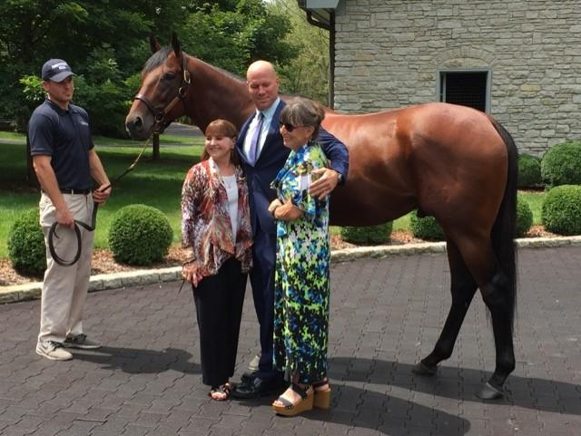 Michael Norris Holds American Pharoah with Deal Newberry, Randall, and Ottley Sims