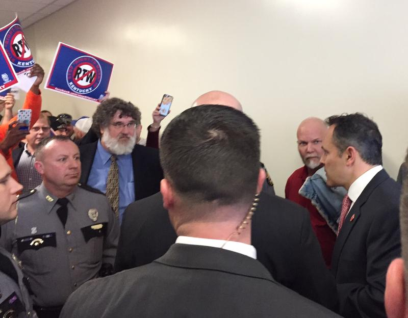 "Union members and supporters confront Gov. Matt Bevin over ""right-to-work"" bill, which they fear will lower wages and undermine unions' bargaining power."
