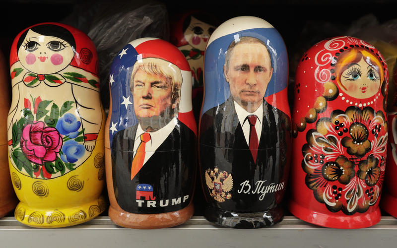 In this Monday, Feb. 20, 2017 traditional Russian wooden dolls called Matryoshka depicting US President Donald Trump, centre left and Russian President Vladimir Putin are displayed for sale at a souvenir street shop in St.Petersburg, Russia.