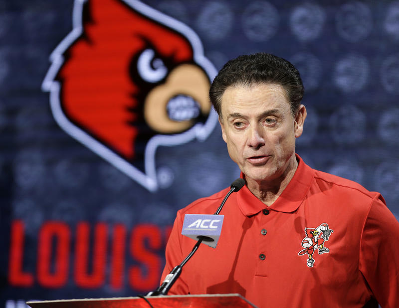 In this Oct. 26, 2016, file photo, Louisville NCAA college basketball head coach Rick Pitino answers a question during the Atlantic Coast Conference media day in Charlotte, N.C.