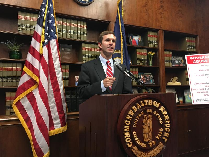 Kentucky Democratic Attorney General Andy Beshear speaks to reporters about his plans to sue Republican Gov. Matt Bevin on Wednesday, June 7, 2017, in Frankfort, Ky.