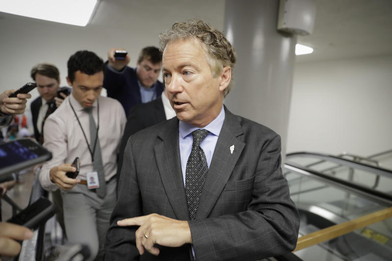 Sen. Rand Paul, R-Ky., a vocal opponent of the Senate Republican healthcare bill, speaks with reporters on his way to a vote on Capitol Hill in Washington, Wednesday, July 12, 2017.