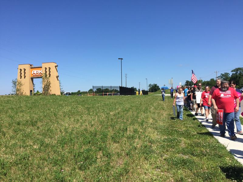 Protesters line the sidewalk outside the Bible-themed Ark Encounter park in Williamstown, KY on July 8, 2017.