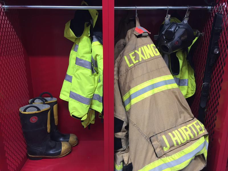 Firefighter gear hangs in a cubby inside Lexington's Fire Station 2 on July 6, 2017.