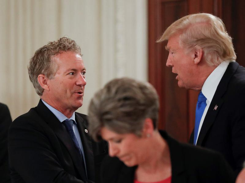 President Donald Trump stops to greet Sen. Rand Paul, R-Ky., center, during a luncheon with GOP leadership, Wednesday, July 19, 2017, in the State Dining Room of the White House in Washington.