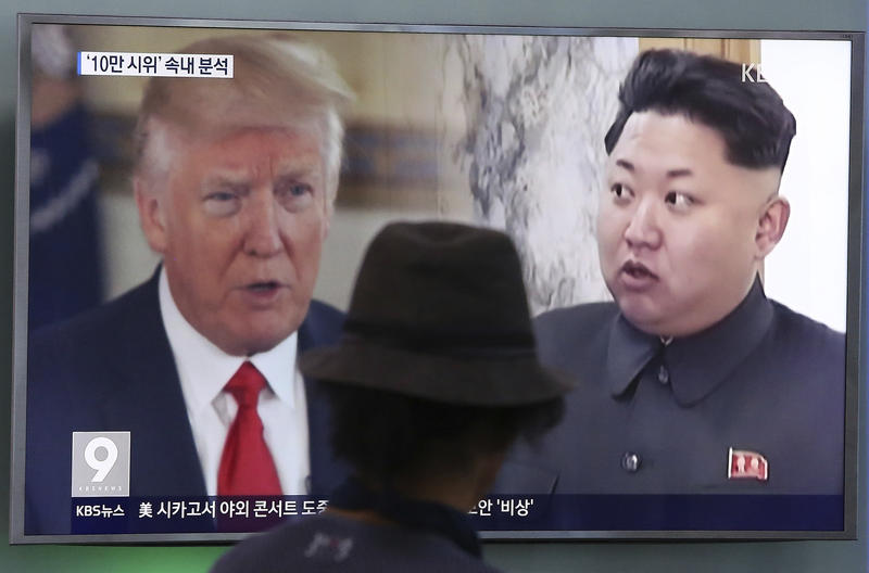 In this file photo, a man watches a television screen showing U.S. President Donald Trump and North Korean leader Kim Jong Un during a news program at the Seoul Train Station in Seoul, South Korea.