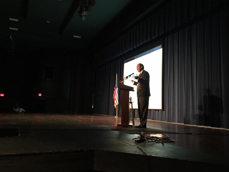 Congressman Andy Barr (R-Lexington) plows through a health presentation over jeers, and occasional cheers, at a Lafayette High School town hall.