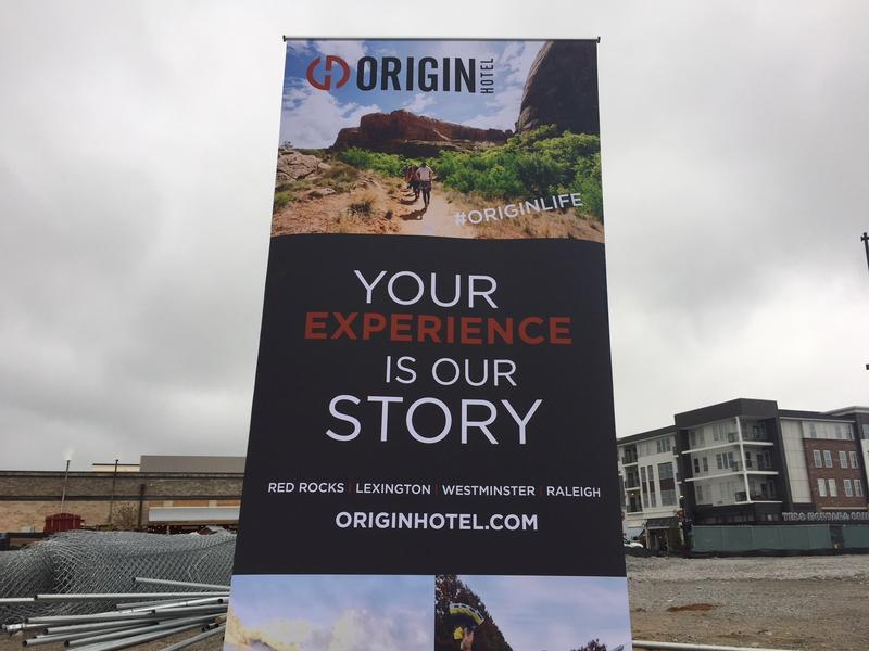 A sign is posted on the lot where developer The Thrash Group plans to build an Origin Hotel on Oct. 12, 2017.