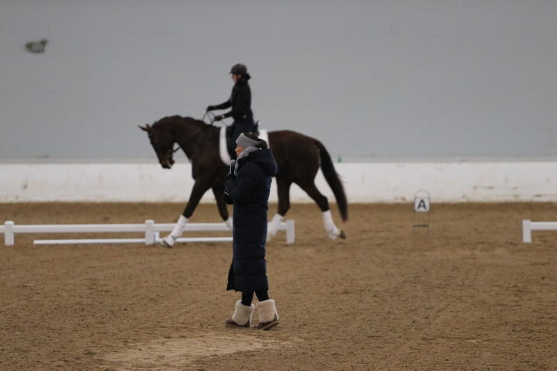 Charlotte Dujardin looks on as horse and rider go through their paces