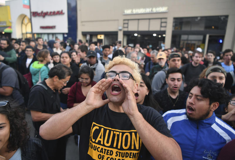 Victor Gonzales shouts with a crowd before a speaking engagement by Ben Shapiro on the campus of the University of California Berkeley in Berkeley, Calif., Thursday, Sept. 14, 2017.