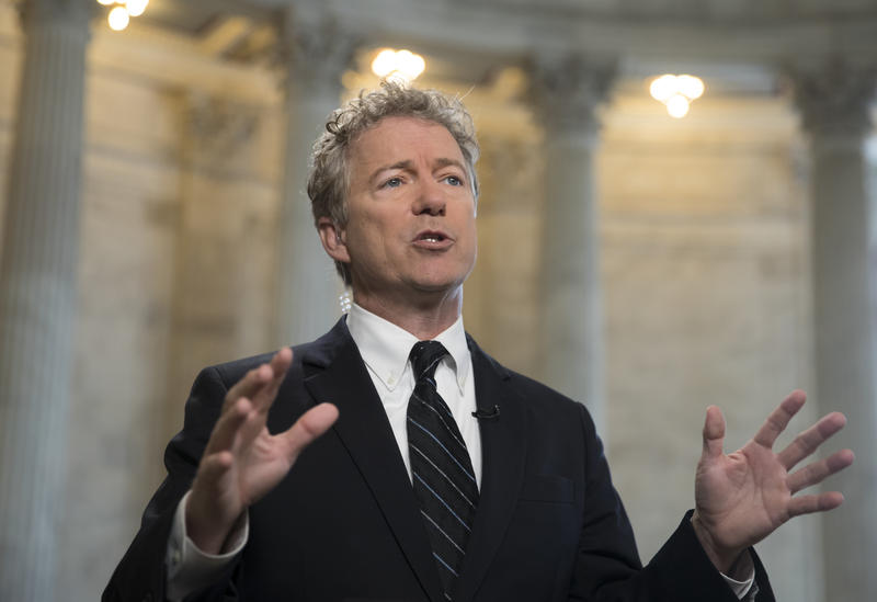 Sen. Rand Paul, R-Ky., speaks during a TV news interview on Capitol Hill in Washington, Wednesday, March 21, 2018.