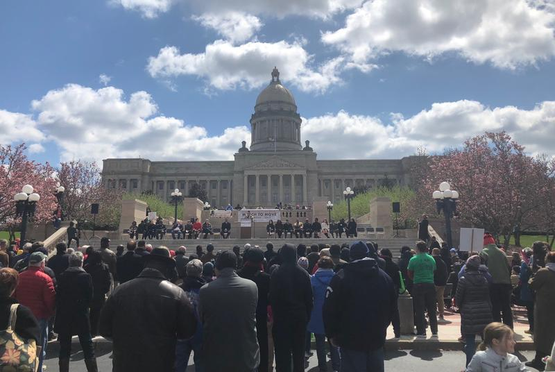 "Marchers cluster at the foot of the Kentucky Capitol on April 4, 2018 for the ""March to Move"" event marking the 50th anniversary of the death of civil rights leader Dr. Martin Luther King, Jr."