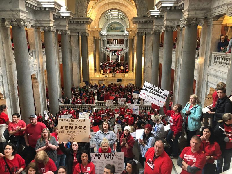 Kentucky senators faced a vocal crowd of red-clad teachers and other protesters as they emerged from the chamber on April 2, 2018.