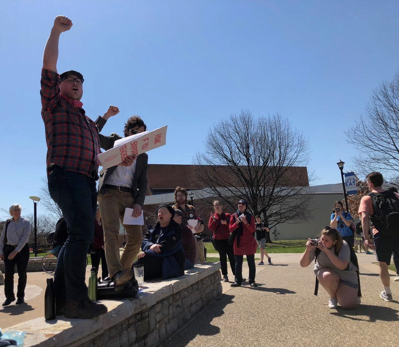 Drew Van't Land, a graduate student studying philosophy at the University of Kentucky, leads a small rally near Bowman's Den on the university's campus on April 12, 2018.