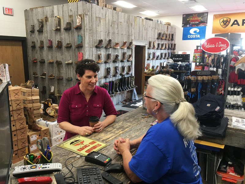 Kentucky 6th Congressional District Democratic candidate Amy McGrath, left, speaks with Vonnie Gesinske at RT Outfitters on Monday, May 21, 2018, in Lexington, Ky.