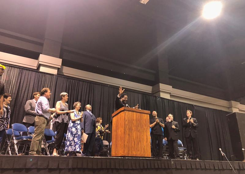 Members of BUILD, or Building a United Interfaith Lexington through Direct-Action, celebrate Lexington Mayor Jim Gray's commitment to put the city on a path toward implementing a nationally-recognized violence prevention program on May 10, 2018.