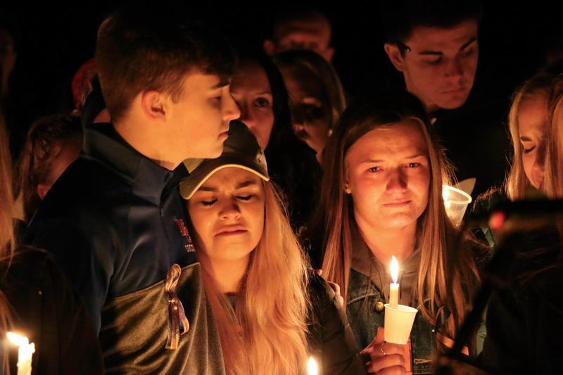 Mourners attend a vigil for the victims of a fatal shooting at Marshall County High School on Thursday, Jan. 25, 2018, at Mike Miller County Park in Benton, Ky.