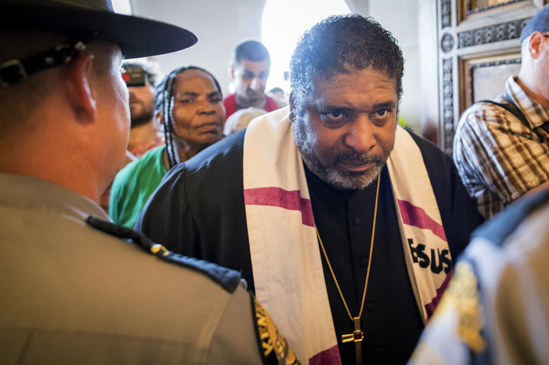Reverend William J. Barber argues with State Troopers at the doors of the state capitol building during a protest organized by Kentucky Poor People's Campaign in Frankfort, Ky., Monday, June 4, 2018.