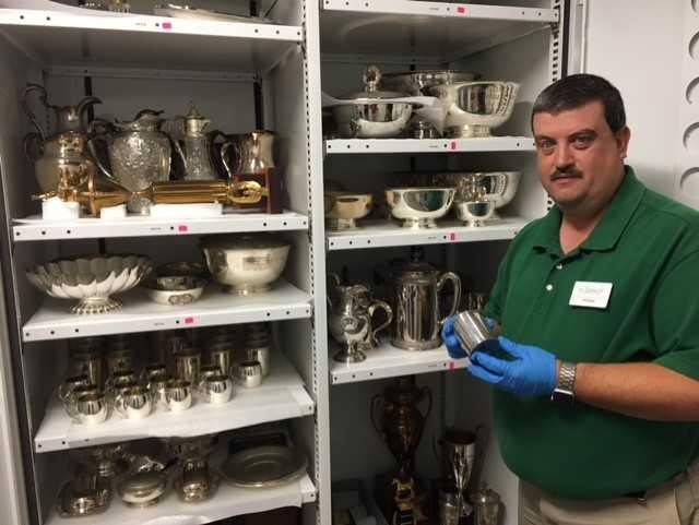 Curator Bill Bright shows off some of the Historical Society's vast bourbon related artifacts