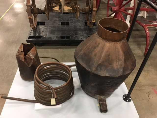 A confiscated moonshine still is one of the many artifacts featured in the Historical Society's Glove Up Tour