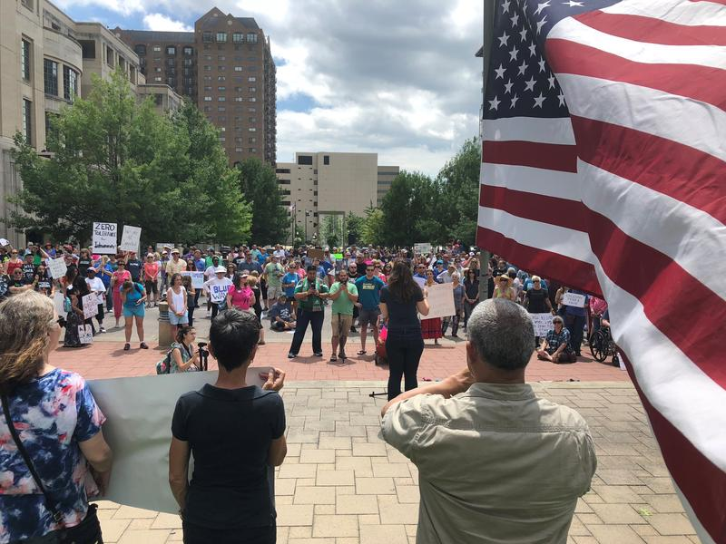 Hundreds of Lexingtonians spilled into the Fayette Circuit Courthouse square to protest the Trump administration's immigrational policies on June 23, 2018.