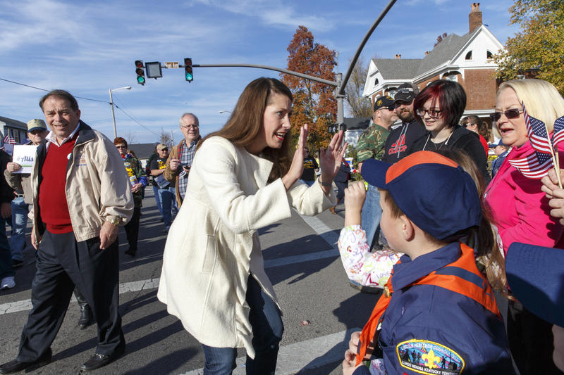 With only two day left in Kentucky's combative U.S. Senate race, Democratic candidate Alison Lundergan Grimes, Ky., greets people at the Veterans Day Parade in Madisonville, Ky., Sunday, Nov. 2, 2014.