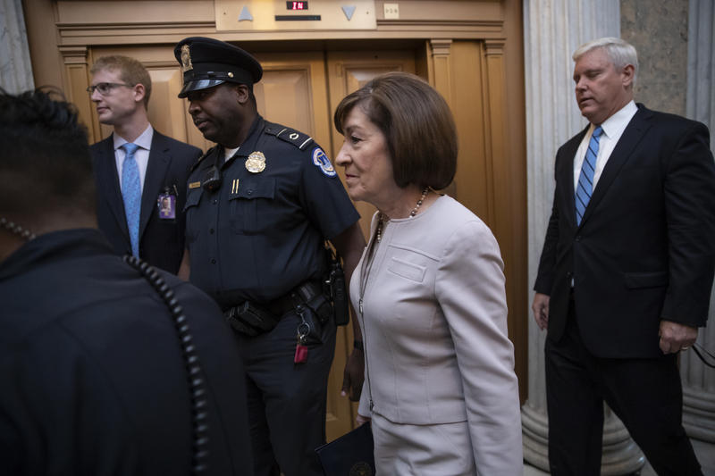Sen. Susan Collins, R-Maine, arrives at the chamber for a procedural vote to advance the confirmation of Supreme Court nominee Brett Kavanaugh, at the Capitol in Washington, Friday, Oct. 4, 2018.