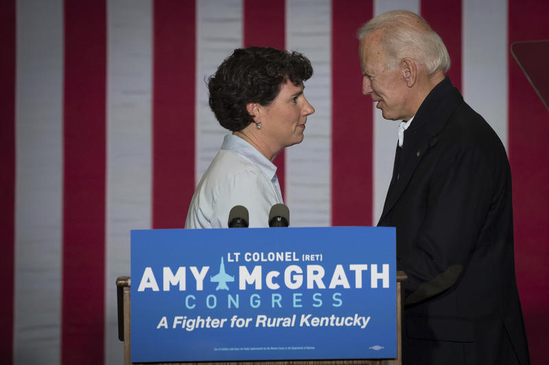 Former Vice President Joe Biden and democratic congressional candidate Amy McGrath shake hands during a campaign event in Owingsville, Ky., Friday, October 12, 2018.