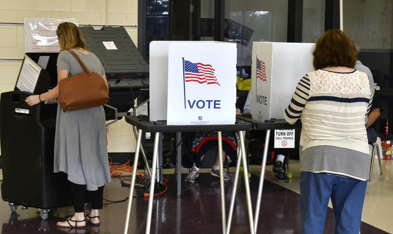 Voters cast their ballots at Cedar Grove Elementary School, Tuesday, Feb. 20, 2018, in Shepherdsville, Ky.