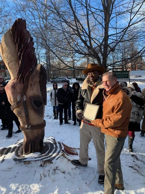 About a hundred people braved the artic cold for the official dedication, and the presentation of the adoption certificate of the tree to Tarus.