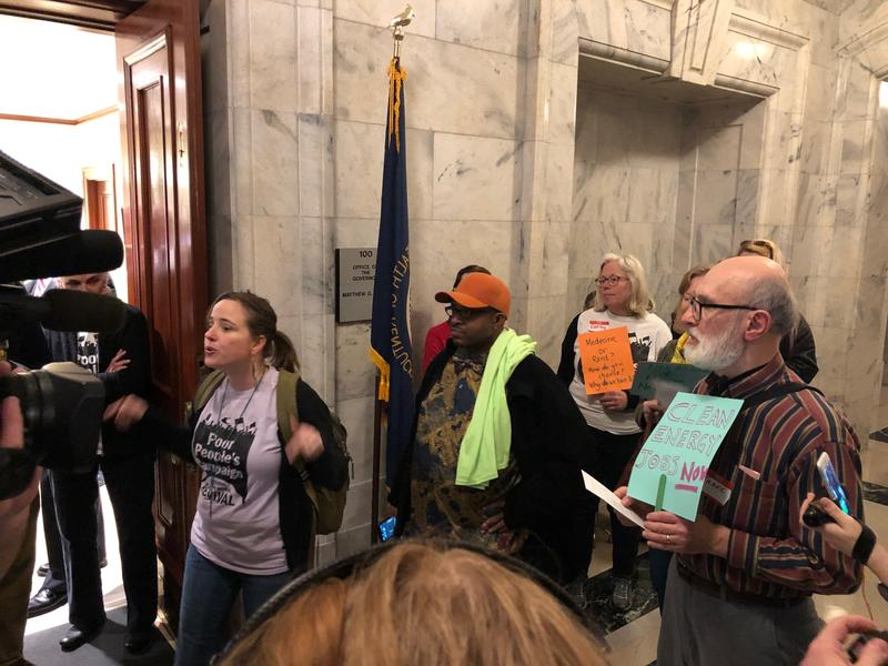 Protesters with the Poor People's Campaign rally outside Governor Matt Bevin's office on February 5, 2019.
